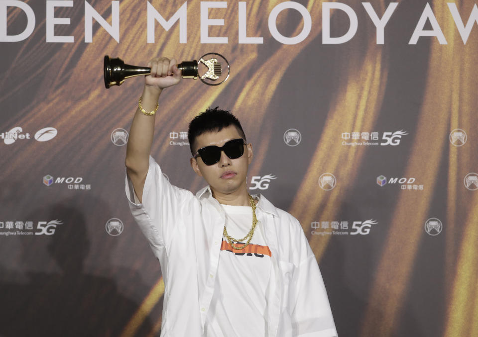 Taiwanese singer Soft Lipa holds his awards of Best Male Singer and Best Album of the 32nd Golden Melody Awards in Taipei, Taiwan, Saturday, Aug. 21, 2021. Golden Melody Awards, one of the world's biggest Chinese-language pop music annual events and postponed from June to Aug. due to the coronavirus pandemic. (AP Photo/Chiang Ying-ying)