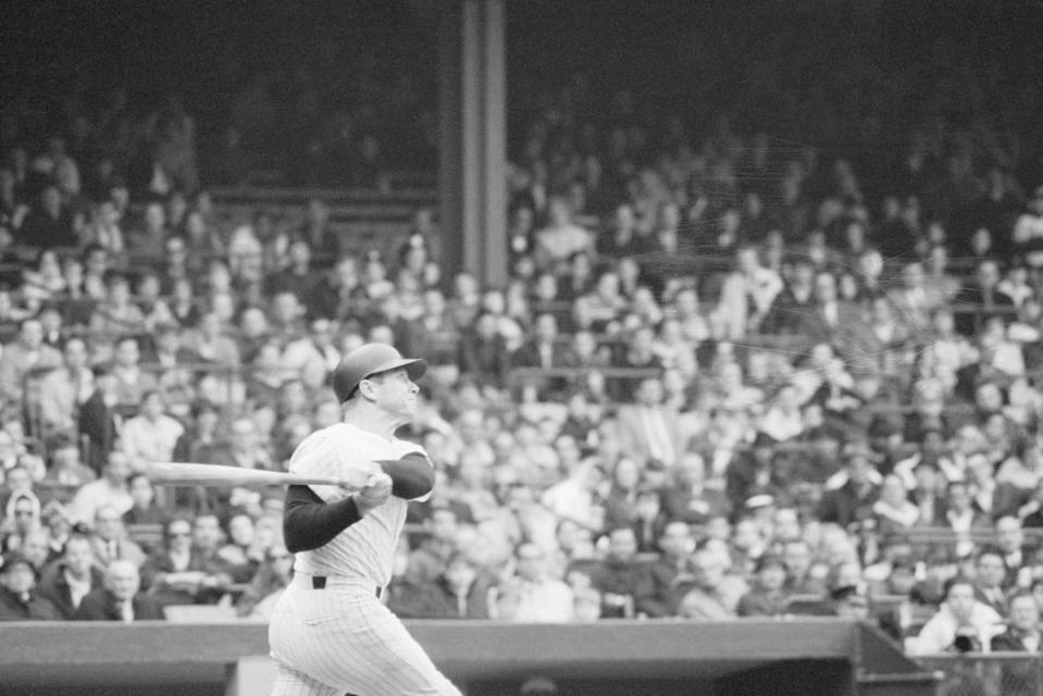 Yankees' batter Mickey Mantle blasts his 500th career home run off Stu Miller in the 7th inning of the May 14th game with Baltimore. Mantle was the 6th player in the major leagues to have hit 500 homers.