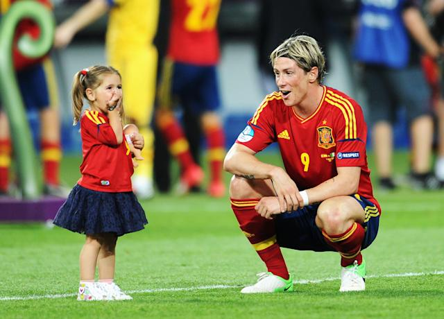 KIEV, UKRAINE - JULY 01: Fernando Torres of Spain speaks with his daughter Nora Torres after the UEFA EURO 2012 final match between Spain and Italy at the Olympic Stadium on July 1, 2012 in Kiev, Ukraine. (Photo by Jasper Juinen/Getty Images)