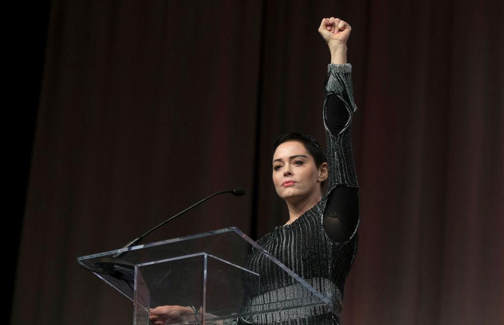 Rose McGowan raises her fist during her opening remarks to the audience at the Women's Convention in Detroit, Mich., on October 27, 2017. (Photo: Rena Laverty/AFP/Getty Images)