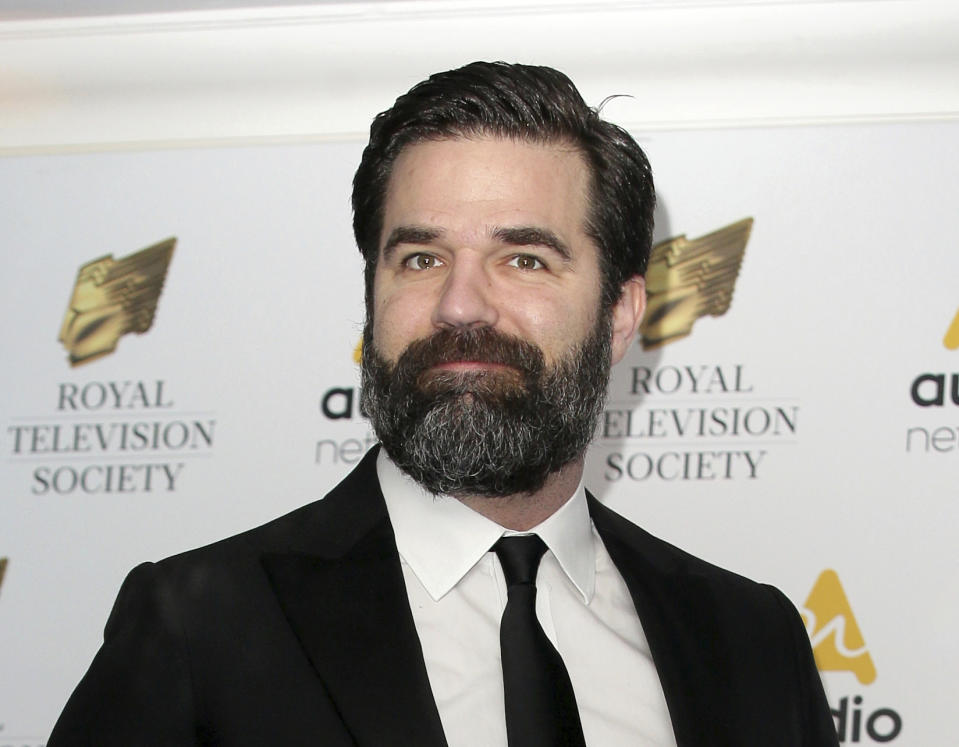"FILE - In this March 21, 2017 file photo, Rob Delaney poses for photographers upon arrival at the Royal Television Society Programme Awards in London. Delaney has announced the death of his infant son from cancer, memorializing the boy as ""smart, funny, and mischievous"" in a Facebook post. Henry Delaney was diagnosed with a brain tumor in 2016, according to his father. After surgery to remove the tumor and treatment early last year, the cancer returned in the fall, and Henry died in January. (AP Photos/Tim Ireland, File)"