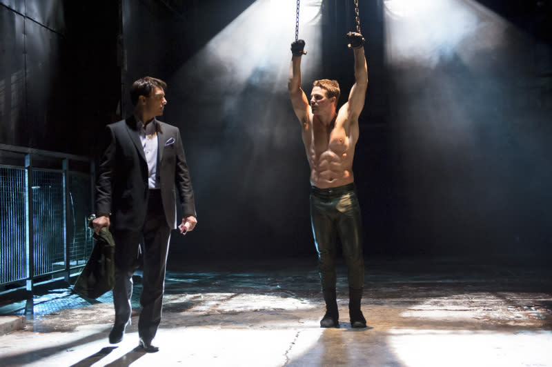 """Sacrifice"" -- John Barrowman as Malcolm Merlyn and Stephen Amell as Oliver Queen"