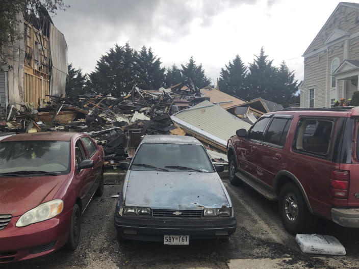 The site of a fire in Woodlawn, Md., where three people were killed, including a suspect, and two others were injured on Saturday, May 8, 2021. (AP Photo/Brian Witte)
