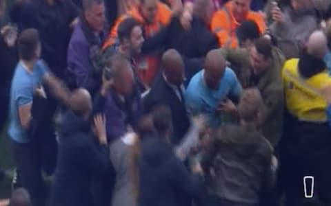 Kompany is escorted off the pitch