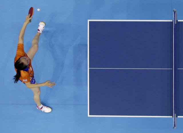 Jiao Li of the Netherlands competes against Li Xiaoxia of China during the women's singles table tennis competition at the 2012 Summer Olympics, Tuesday, July 31, 2012, in London. (AP Photo/Sergei Grits)