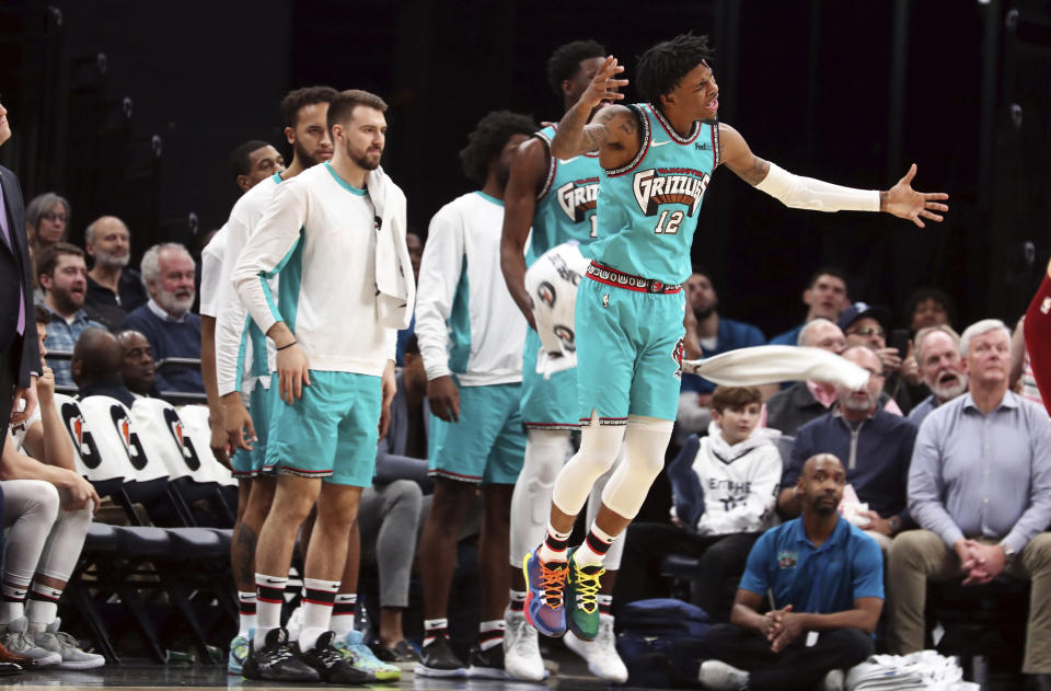 Memphis Grizzlies guard Ja Morant (12) reacts to a call during the second half of the team's NBA basketball game against the Cleveland Cavaliers on Friday, Jan. 17, 2020, in Memphis, Tenn. (AP Photo/Karen Pulfer Focht)