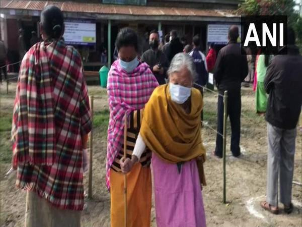 An elderly woman coming out from a polling booth in Imphal after casting her vote on Saturday.