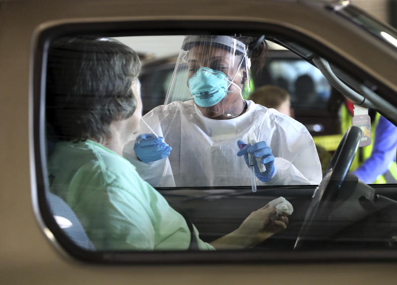 "Emory Hospital RN Aisha Bennett takes a nasal swab at a pilot large scale drive-through COVID-19 testing site in the Georgia International Horse Park on Thursday, April 16, 2020, in Conyers, Ga. Testing is by appointment only and open to anyone in the general public who believes they are ill with COVID-19. According to Chad Wasdin, communications director for the Gwinnett Rockdale Newton Health Departments, due to increased testing capacity 400 appointments are scheduled for anyone who thinks they may be ill with the virus. While the Health Department requires a scheduled appointment to test individuals, referral from a doctor is not necessary. There is no charge for the testing, and those tested do not need to provide health insurance information. ""We look forward to piloting this large-scale test site,"" said Dr. Audrey Arona, district health director and CEO of Gwinnett, Newton and Rockdale County Health Departments. ""This is a fantastic collaboration between Rockdale and Newton county governments, their EMAs, and the Health Department. Testing will provide individuals in the community an opportunity to learn if their illness is consistent with the COVID-19 virus, and it will help us improve our plans for providing large-scale testing. (Curtis Compton/Atlanta Journal-Constitution via AP)"