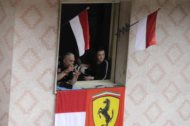 Spectators watch the third free practice at the Monaco racetrack, in Monaco, Saturday, May 25, 2019. The Formula one race will be held on Sunday. (AP Photo/Luca Bruno)