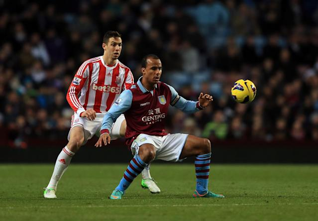 BIRMINGHAM, ENGLAND - DECEMBER 08: Gabriel Agbonlahor of Villa holds off Geoff Cameron of Stoke during the Barclays Premier League match between Aston Villa and Stoke City at Villa Park on December 8, 2012 in Birmingham, England. (Photo by Richard Heathcote/Getty Images)