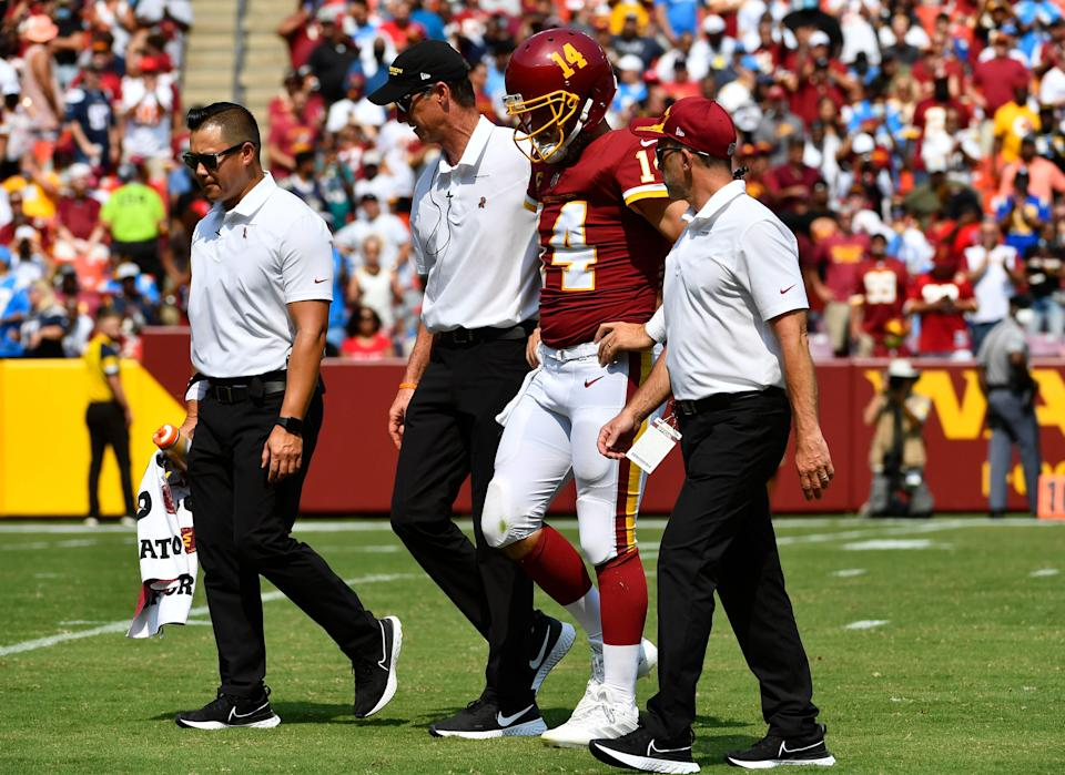 Washington Football Team QB Ryan Fitzpatrick leaves the field after injuring his hip Sunday against the Chargers.