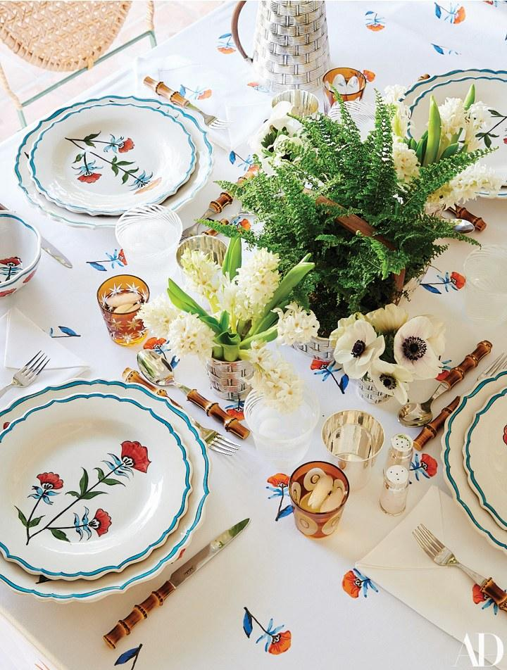 Table linens, plates, and glasses of de Ravenel's own design.