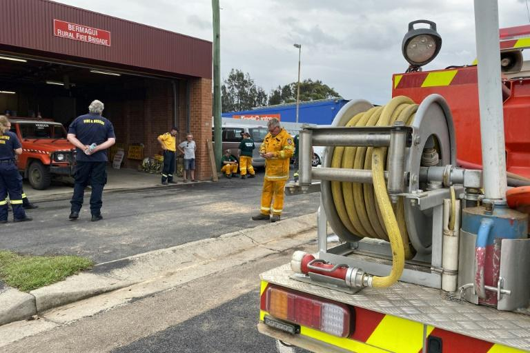 Volunteers help fight bushfires with the Rural Fire Service in Bermagui on Australia's southeast coast