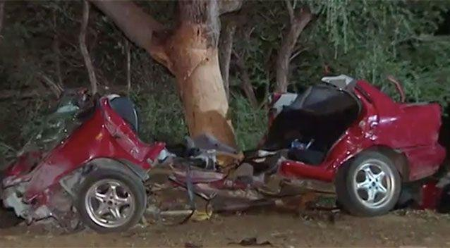 The car was a mangled wreck after the crash. Source: 7 News/Facebook