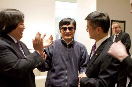 Chinese dissident Chen Guangcheng (C) shakes hands with Gary Locke (R), US ambassador to China in Beijing. Chen's flight came despite round-the-clock surveillance at his house in Shandong, where he has alleged that he and his family suffered severe beatings after he ended a four-year jail term in 2010