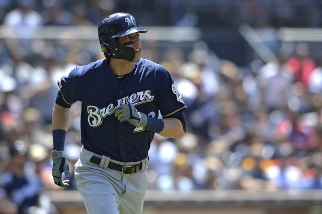 Milwaukee Brewers' Christian Yelich watches his home run during the fifth inning of a baseball game against the San Diego Padres Wednesday, June 19, 2019, in San Diego. (AP Photo/Orlando Ramirez)