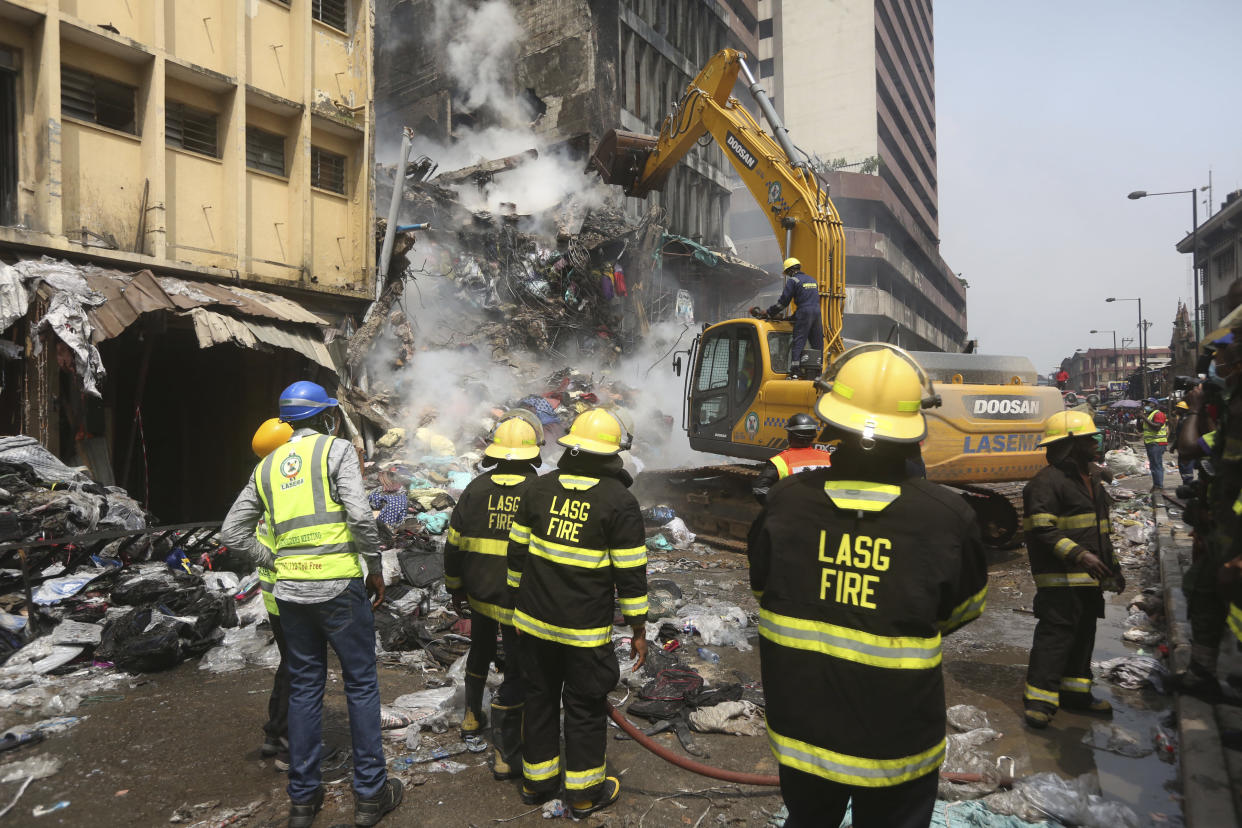 A crane operator works at the site of a fire in Balogun Market in downtown Lagos, Nigeria, Nov. 6, 2019. (Photo: Sunday Alamba/AP)