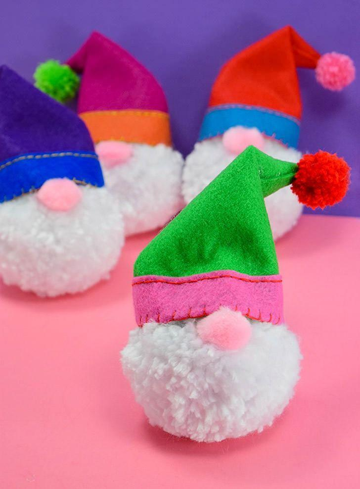 """<p>If you don't know how to sew, opt to purchase mini Santa hats instead. You'll still end up with a gnome that's as cute as can be. </p><p><em>Get the tutorial at <a href=""""https://www.dreamalittlebigger.com/post/pompom-gnome-christmas-ornaments.html"""" rel=""""nofollow noopener"""" target=""""_blank"""" data-ylk=""""slk:Dream a Little Bigger"""" class=""""link rapid-noclick-resp"""">Dream a Little Bigger</a>.</em></p><p><a class=""""link rapid-noclick-resp"""" href=""""https://www.amazon.com/Elcoho-Picese-Christmas-Lollipop-Decorations/dp/B07JBVJJ7J?tag=syn-yahoo-20&ascsubtag=%5Bartid%7C10072.g.34443405%5Bsrc%7Cyahoo-us"""" rel=""""nofollow noopener"""" target=""""_blank"""" data-ylk=""""slk:SHOP MINI SANTA HATS"""">SHOP MINI SANTA HATS</a></p>"""