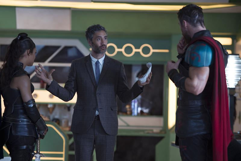 Taika Waititi, Tessa Thompson and Chris Hemsworth on the set of Thor: Ragnarok (Credit: Marvel/Disney)