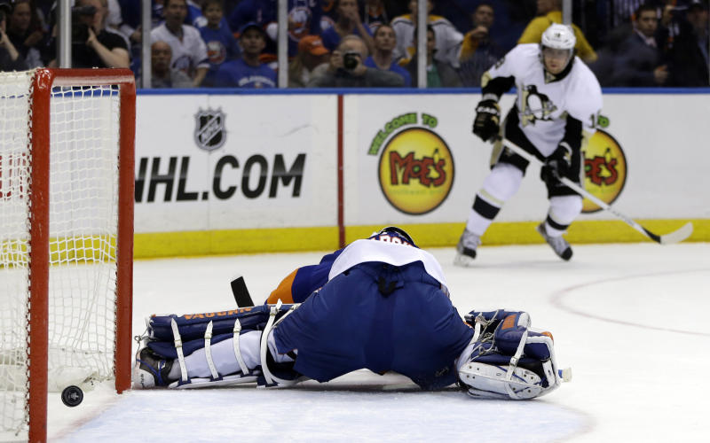 Pittsburgh Penguins left wing James Neal (18) watches as his shot goes past New York Islanders goalie Evgeni Nabokov (20), of Russia, in the first period of Game 4 of their first-round NHL hockey Stanley Cup playoffs hockey series at Nassau Coliseum in Uniondale, N.Y., Tuesday, May 7, 2013. (AP Photo/Kathy Willens)