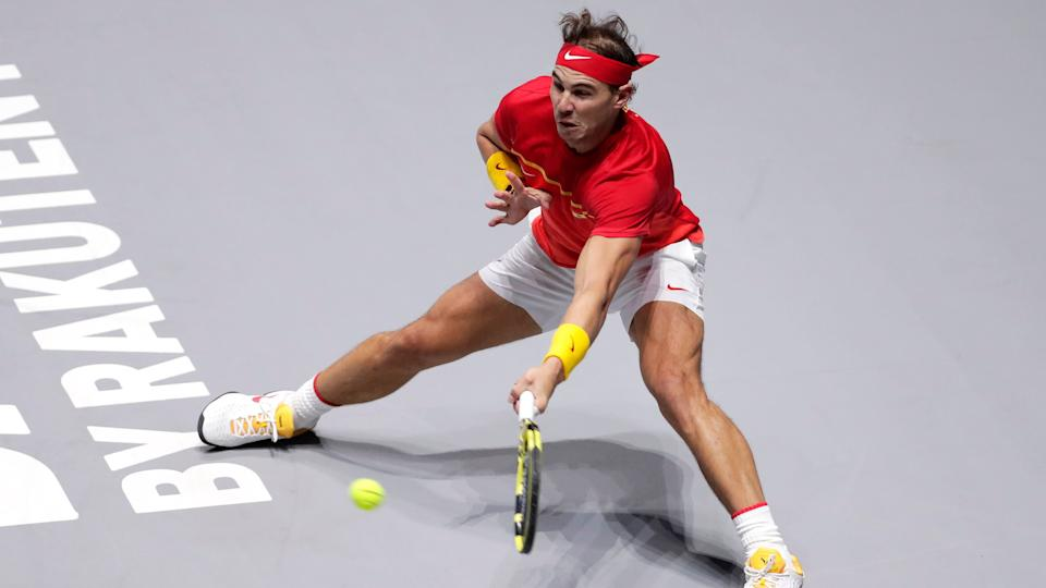 Spain's Rafael Nadal returns the ball to Croatia's Borna Gojo during their Davis Cup tennis match in Madrid, Spain.
