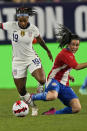 U.S. midfielder Catrina Macario (19) and Paraguay midfielder Fanny Godoy (10) vie for the ball during the first half of an international friendly soccer match Thursday, Sept. 16, 2021, in Cleveland. (AP Photo/Tony Dejak)