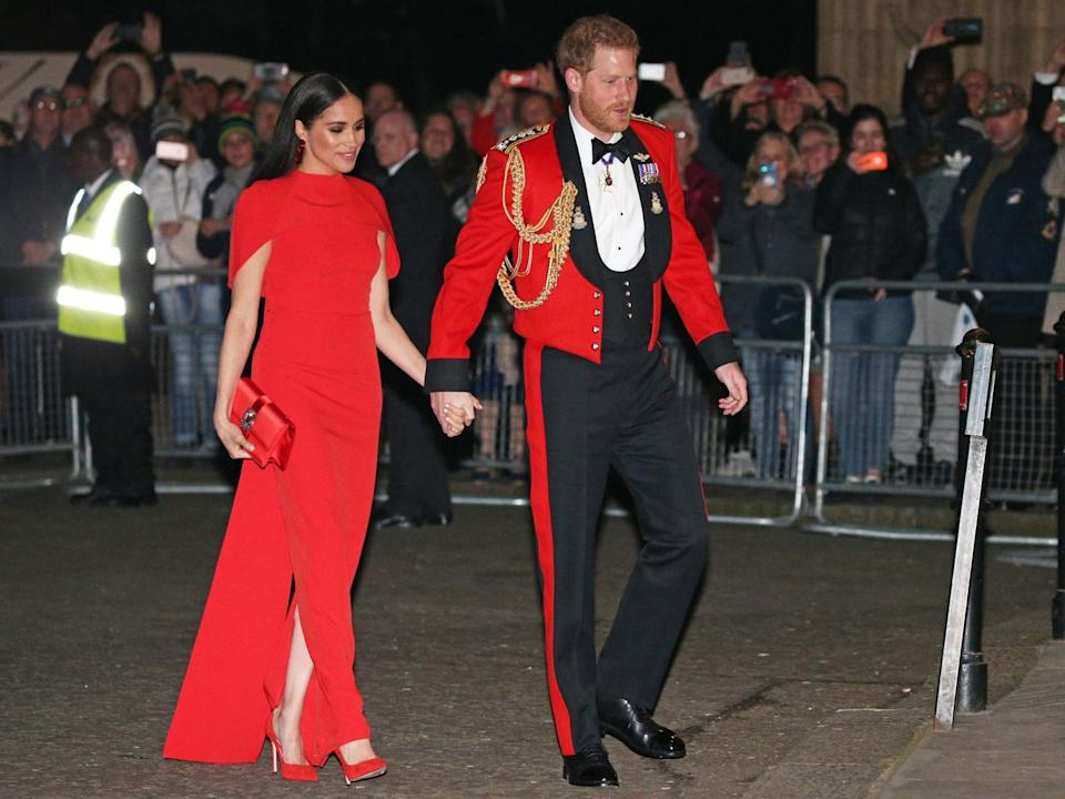 Harry and Meghan arrive at the Mountbatten Festival of Music in matching outfits PA
