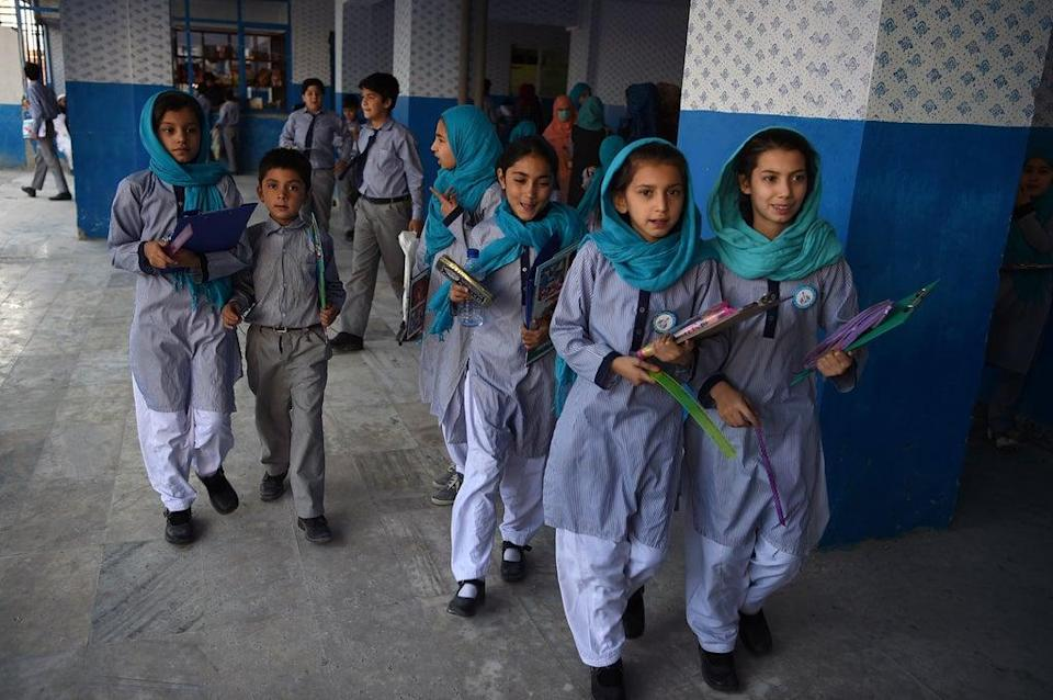 Afghan schoolgirls leave after the mid-term exams at a school in Kabul in 2019 (AFP via Getty)