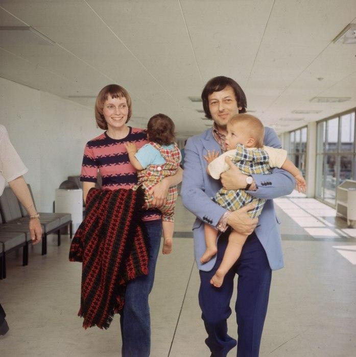 """<div class=""""caption-credit""""> Photo by: Courtesy of Getty Images</div><div class=""""caption-title""""></div>Farrow and Previn, holding twins Sascha and Matthew, respectively, walk through the airport in London, where the couple was living, in 1971."""