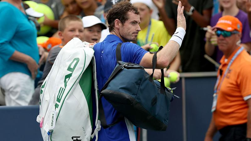 Andy Murray leaves the court after losing to Richard Gasquet in his comeback to singles. (Photo by Rob Carr/Getty Images)