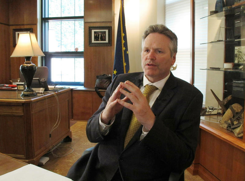 FILE  - In this May 29, 2019, file photo, Alaska Gov. Mike Dunleavy speaks to reporters in his office at the state Capitol in Juneau, Alaska. A fight is brewing over whether Dunleavy, a Republican who took office in Dec. 2018, should be recalled. Critics say he's incompetent and has recklessly tried to cut spending while supporters see a politically motivated attempt to undo the last election. (AP Photo/Becky Bohrer, File)
