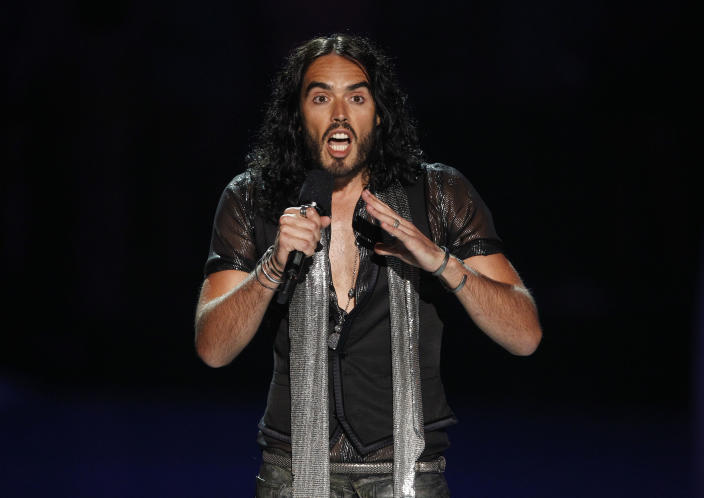 Russell Brand is seen on stage during a tribute for Amy Winehouse at the MTV Video Music Awards on Sunday Aug. 28, 2011, in Los Angeles. (AP Photo/Matt Sayles)