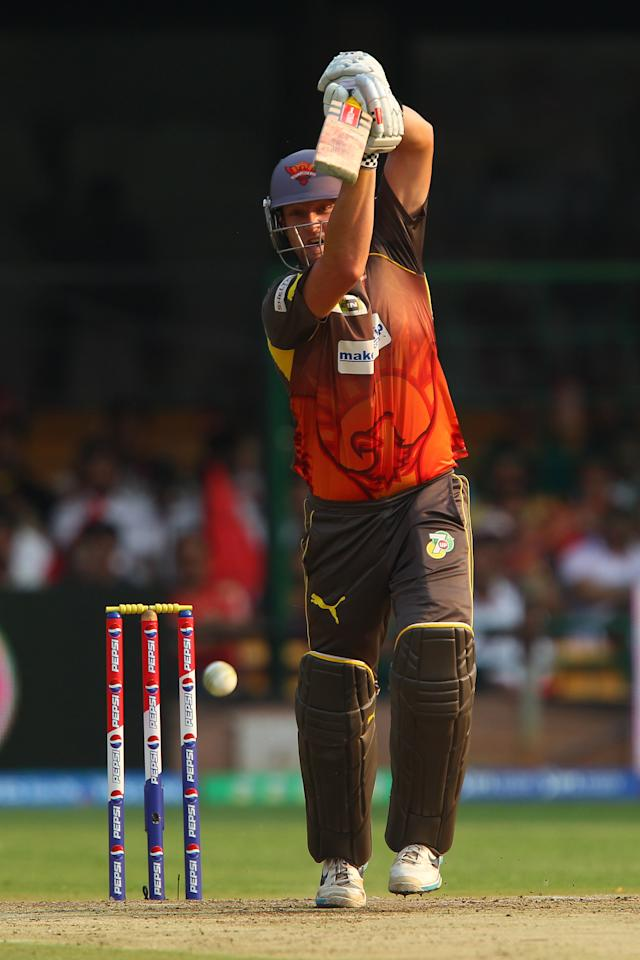 Cameron White drives straight during match 9 of of the Pepsi Indian Premier League between The Royal Challengers Bangalore and The Sunrisers Hyderabad held at the M. Chinnaswamy Stadium, Bengaluru on the 9th April 2013. (BCCI)