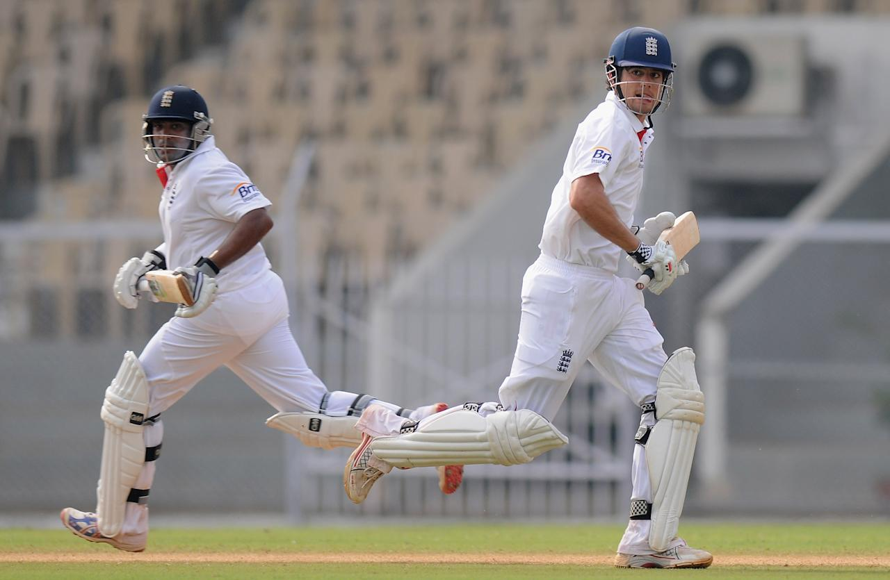 MUMBAI, INDIA - OCTOBER 31:  Samit Patel and Alastair Cook of England run between the wickets during the second day of the first practice match between England and India 'A' at the CCI (Cricket Club of India) ground, on October 31, 2012 in Mumbai, India.  (Photo by Pal Pillai/Getty Images)