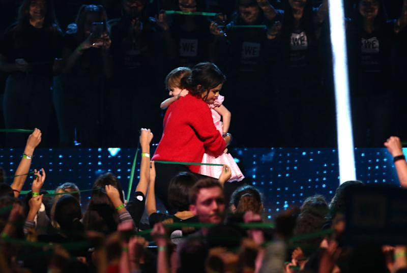 Selena Gomez hugs Nellie Mainor onstage at WE Day California on April 19, 2018, in Inglewood, Calif. (Photo: Tommaso Boddi/Getty Images for WE)