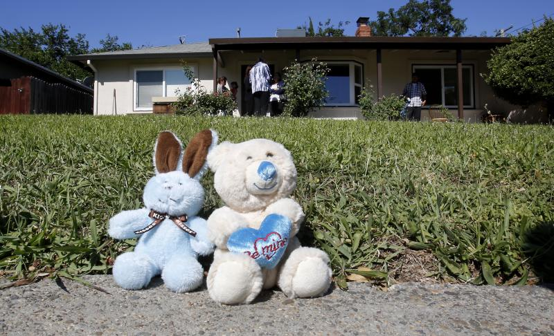 A pair of toy animals are seen as part of memorial outside the home, Monday, May 20, 2013, where Elvira Campos, 10, was shot and killed in North Highlands, Calif. Campos had been watching television with her parents Saturday night, when at least two gunmen walked up to the door of the home and began shooting.  About a dozen shots were fired, killing Campos' and wounding her father and mother. (AP Photo/Rich Pedroncelli)