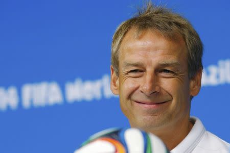 REFILE - CORRECTING SPELLING OF FIRST NAME United States national soccer team head coach Juergen Klinsmann smiles while answering a question during a news conference at the Pernambuco arena in Recife June 25, 2014. REUTERS/Brian Snyder