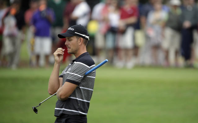 Henrik Stenson, of Sweden, waits to putt on the sixth hole during the third round of play in the Tour Championship golf tournament at East Lake Golf Club, in Atlanta, Saturday, Sept. 21, 2013. (AP Photo/David Goldman)
