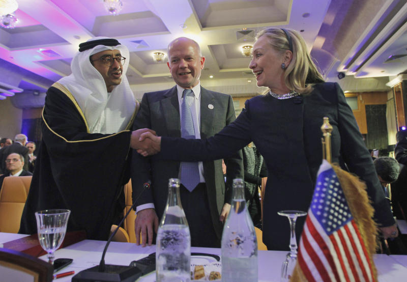 U.S. Secretary of State Hillary Rodham Clinton, right, shakes hands with United Arab Emirates' Foreign Minister Sheikh Abdullah bin Zayed al-Nahyan, left, with British Foreign Minister William Hague at center, at the Friends of Syria Conference in Tunis, Tunisia on Friday Feb. 24, 2012. In an effort to jolt Syria's president into accepting demands for a democratic transition, more than 60 nations give the U.N. a green light to begin planning a civilian peacekeeping mission after the Assad regime stops its bloody crackdown on the opposition. (AP Photo/Jason Reed, Pool)