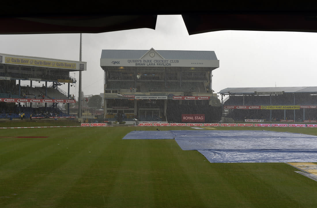 Rain pours during the sixth match of the Tri-Nation series between India and Sri Lanka at the Queen's Park Oval stadium in Port of Spain on July 9, 2013. The match is at halt due to rain. AFP PHOTO/Jewel Samad