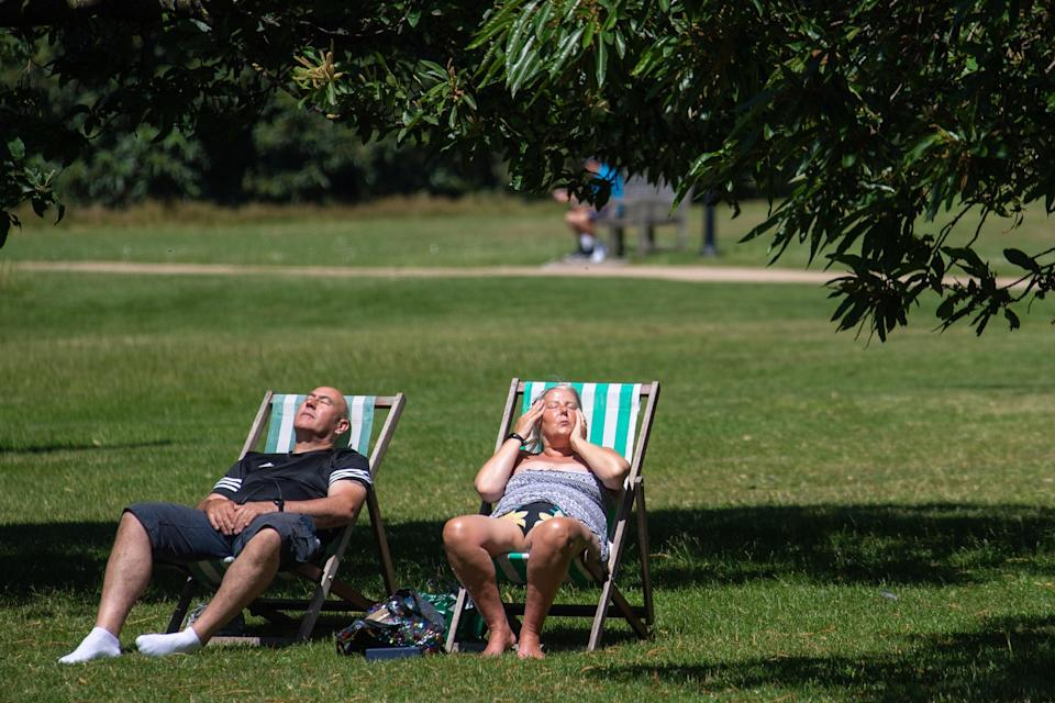 People enjoy the summer sun in deck chairs in Hyde Park, London (PA) (PA Wire)