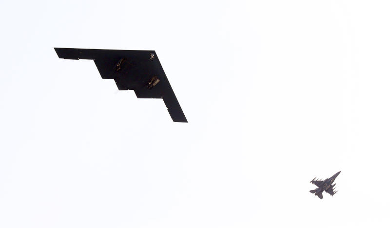 U.S. Air Force B-2 stealth bomber, left, flies over near Osan U.S. Air Base in Pyeongtaek, south of Seoul, South Korea, Thursday, March 28, 2013. A day after shutting down a key military hotline, Pyongyang instead used indirect communications with Seoul to allow South Koreans to cross the heavily armed border and work at a factory complex that is the last major symbol of inter-Korean cooperation. (AP Photo/Lee Jung-hun, Yonhap) KOREA OUT