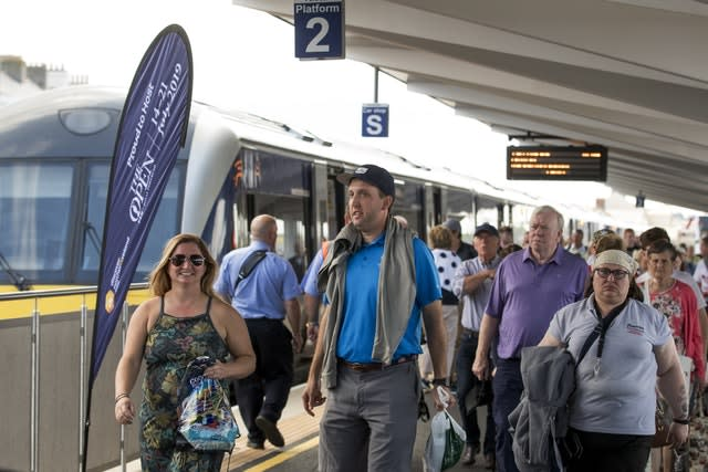 Golf fans and visitors getting off the train in Portrush