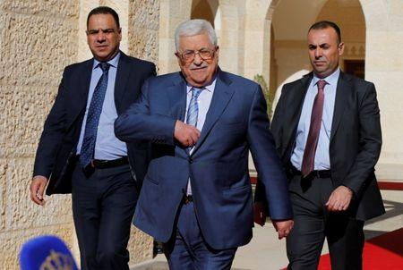 Palestinian President Mahmoud Abbas walks to speaks to the media after his meeting with Jordan's King Abdullah  at the Royal Palace in Amman