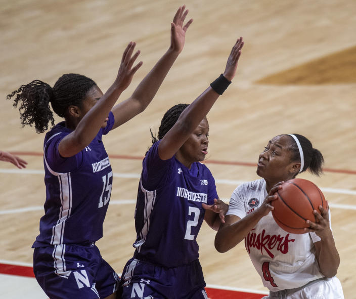 Nebraska's Sam Haiby (4) drives to the basket against Northwestern's Courtney Shaw (15) and Lauryn Satterwhite (2) in the first half of an NCAA college basketball game Thursday, Dec. 31, 2020, in Lincoln, Neb. (Francis Gardler/Lincoln Journal Star via AP)