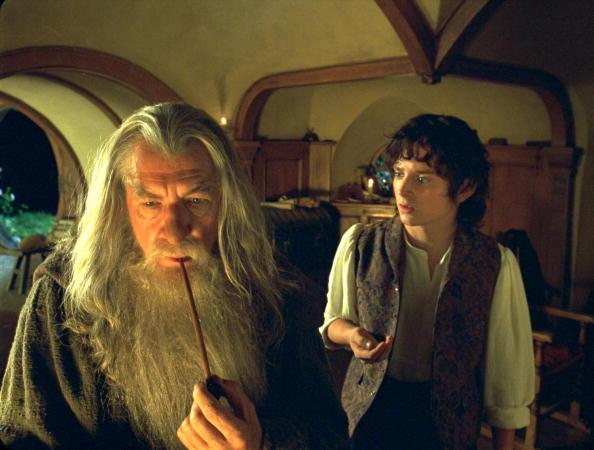 """Ian McKellen as Gandalf and Elijah Wood as Frodo in <em>The Lord of the Rings: The Fellowship of the Ring</em><span class=""""copyright"""">New Line/WireImage</span>"""