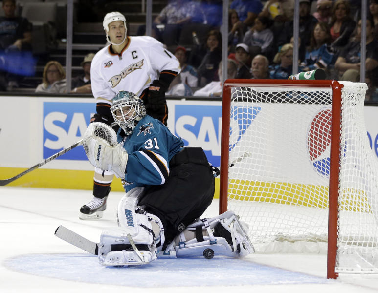 San Jose Sharks goalie Antti Niemi (31), of Finland, is beaten for a goal by Anaheim Ducks' Corey Perry, not pictured, during the second period of a preseason NHL hockey game on Friday, Sept. 20, 2013, in San Jose, Calif. (AP Photo/Marcio Jose Sanchez)