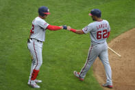 Washington Nationals' Juan Soto, left, fist-bumps Luis Garcia (62) after Garcia scored on a sacrifice by Trea Turner during the fifth inning of the team's baseball game against the Philadelphia Phillies, Thursday, Sept. 3, 2020, in Philadelphia. (AP Photo/Derik Hamilton)
