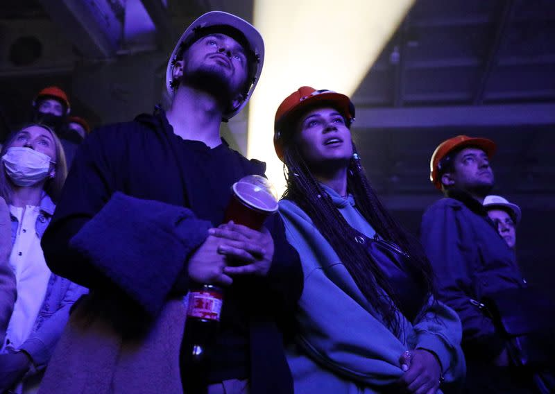 """Spectators watch the """"Romeo and Juliet"""" play staged in the industrial halls of an old Soviet factory in Ivano-Frankivsk"""