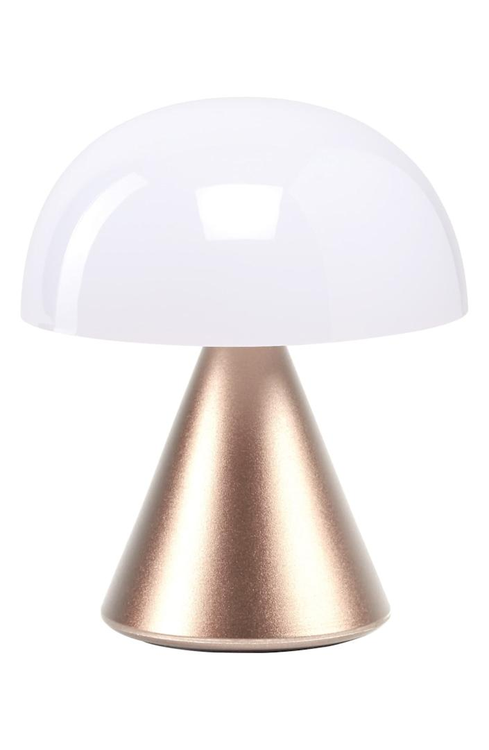 """This portable LED lamp features warm and cool settings, a dimmer setting and a six-hour battery life. It comes with a USB-charging cable and LED bulb. Plus, it has an Art Deco vibe that's <a href=""""https://www.washingtonpost.com/lifestyle/magazine/a-century-after-art-decos-birth-designers-say-were-due-for-a-revival/2020/04/01/8b0e1826-5d7f-11ea-b014-4fafa866bb81_story.html"""" rel=""""nofollow noopener"""" target=""""_blank"""" data-ylk=""""slk:pretty popular"""" class=""""link rapid-noclick-resp"""">pretty popular</a> right now. <a href=""""https://fave.co/32zqgJf"""" rel=""""nofollow noopener"""" target=""""_blank"""" data-ylk=""""slk:Find it for $30 at Nordstrom"""" class=""""link rapid-noclick-resp"""">Find it for $30 at Nordstrom</a>."""